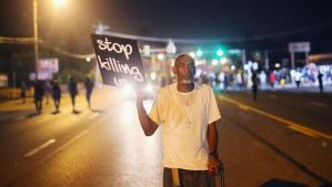 A protestor in Ferguson.  (CBS News photo)