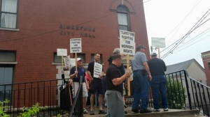 Union members protest outside City Hall before the July 7 meeting. (Biddeford Teamsters photo)